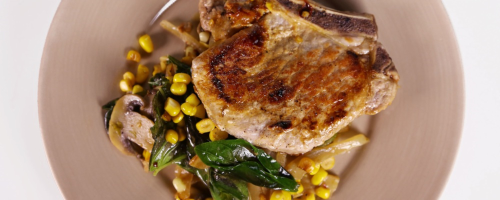 Michael Symon\'s Pork Chops with Basil Creamed Corn