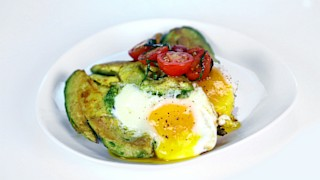 Eggs in Avocado with Tomato and Basil