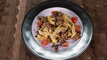 Creamy Fettuccine with Spicy Sausage and Cherry Tomatoes