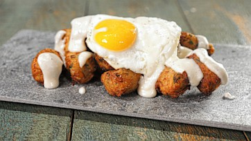 Tater Tots with Fried Eggs and Cheese Sauce